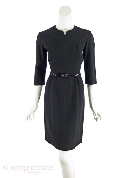 late 50s or early 60s black wiggle dress shown with belt