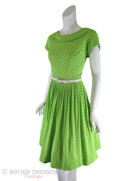 60s Lime Green Polka Dot Dress - angle, with crinoline and belt