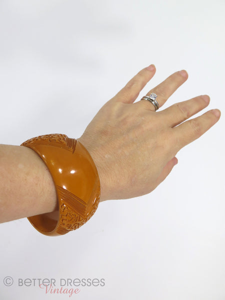 40s Butterscotch Wide Carved Bakelite Bangle - on an arm