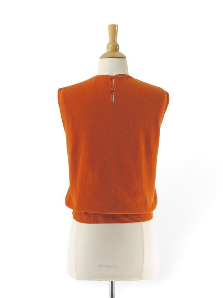 back view of vintage 60s pumpkin color sweater vest