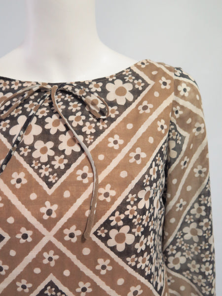 Detail view of 60s shift dress in flower-power floral