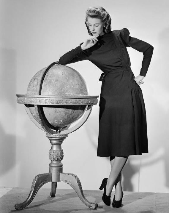 40s woman with globe