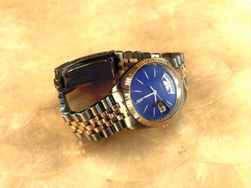 Stamper 10 atm Water Resistant Swiss Parts Face Gold Silver Tone Blue Face Watch