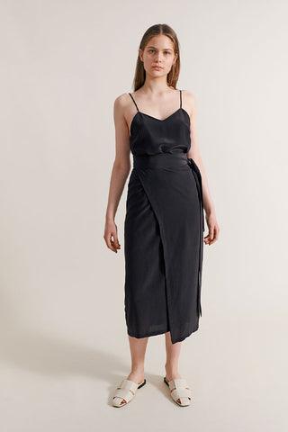 Girl wearing silk slip dress and wrap skirt