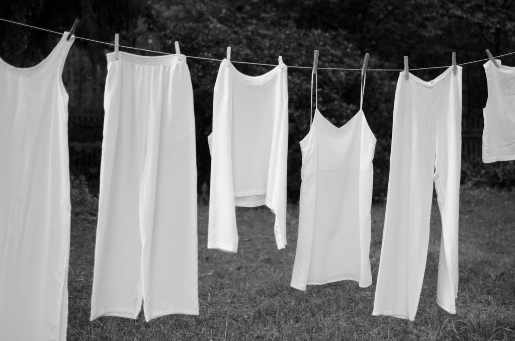 white clothes hanging to dry