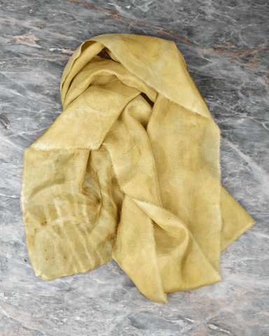 Sil scarf yellow on marble table
