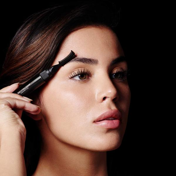 Using the comb side of the unique styling tool, shape and align brow hairs with short, upward strokes following the natural arch of your eyebrows.