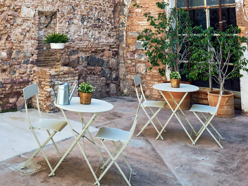 Make the most of your patio this summer: Create inviting spaces with furniture that encourages you to spend time outside.