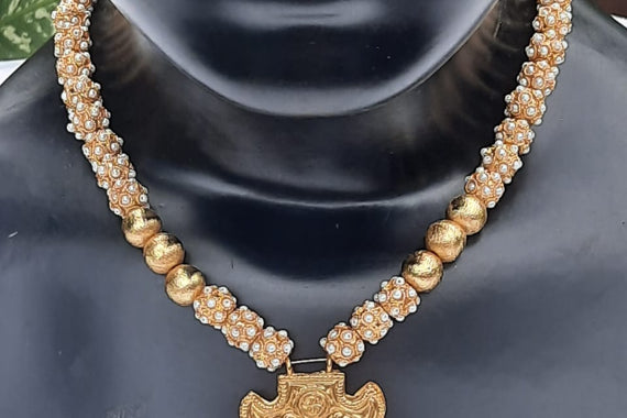 Pearl Encrusted And Golden Beads With A Gold-Plated Pendant