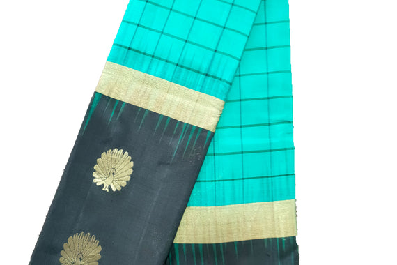 Pure silk saree with contrast border and zari butta