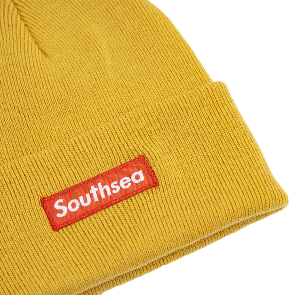"Bored of Southsea ""Southsea"" Beanie in Mustard - Detail"