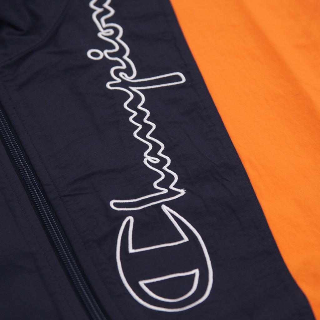 Champion Reverse Weave Taped Track Jacket in Navy / Bright Orange / White - Embroidery