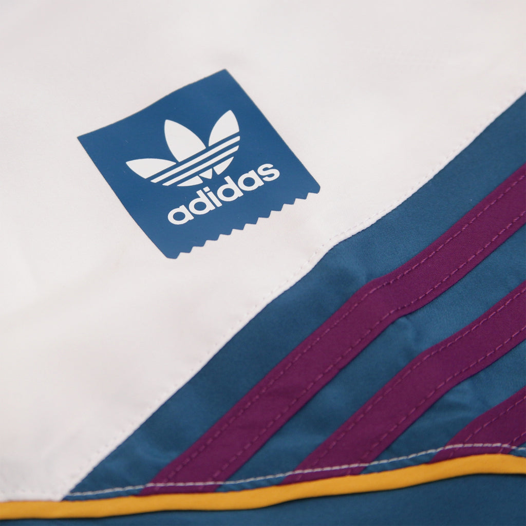 Adidas Skateboarding The Court Jacket in White / Collegiate Navy / Tribe Purple / Real Teal - Left Breast
