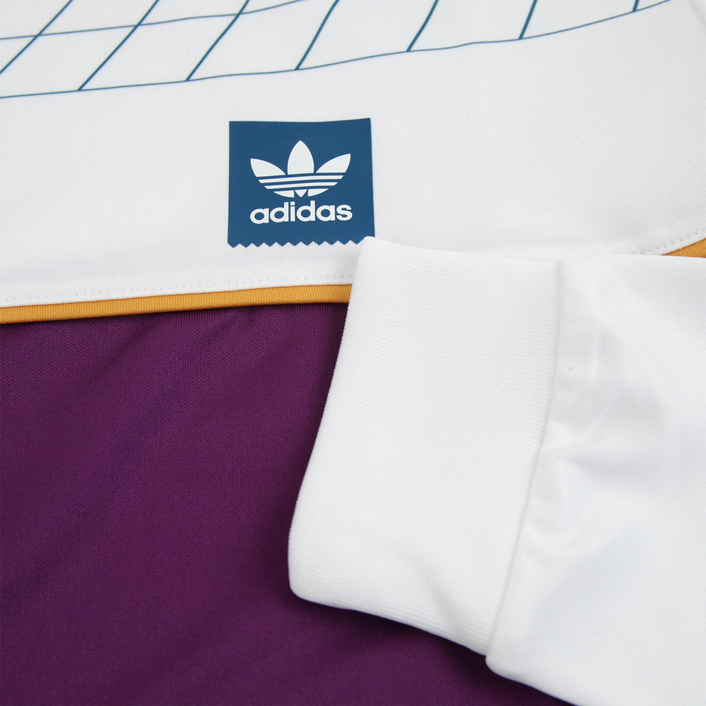 Adidas Skateboarding Tennis Jersey in White / Tribe Purple / Real Teal - Left breast