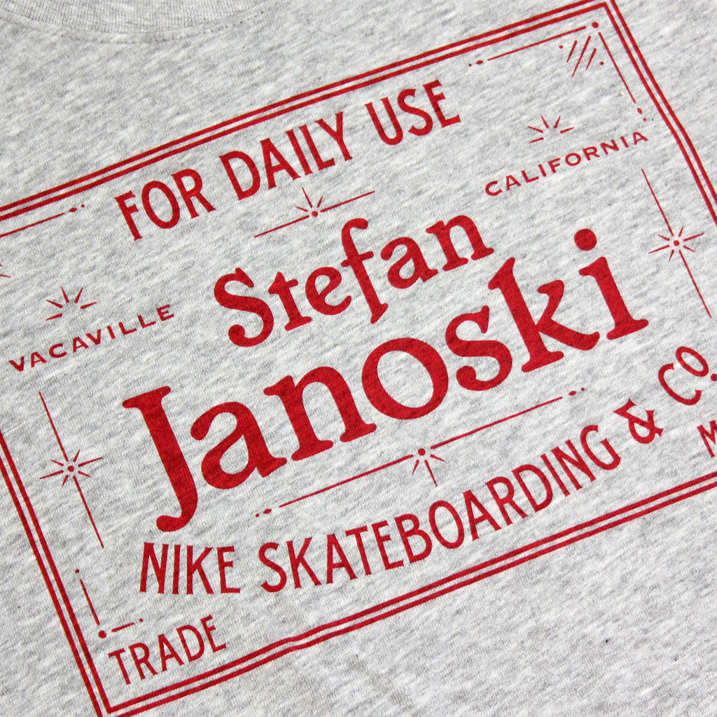 Nike SB Dri-Fit Janoski Label T Shirt in Dark Heather Grey / Gym Red - Print