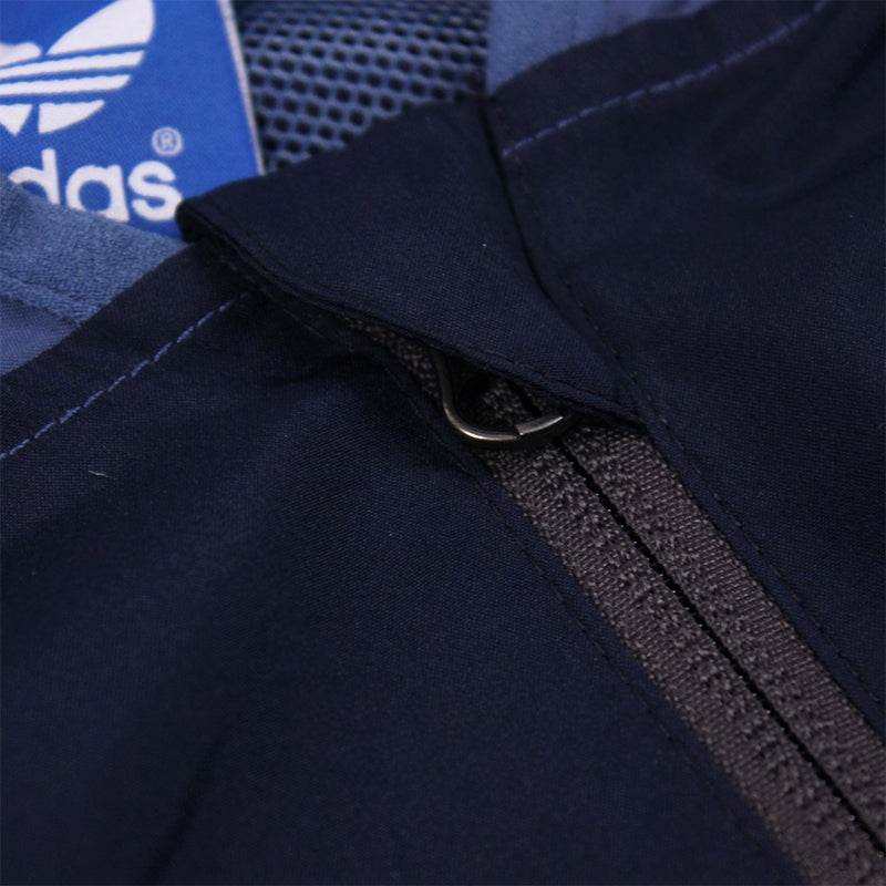 Adidas Skateboarding ADV Wind Jacket in Ash Blue/Collegiate Navy - Zip Detail