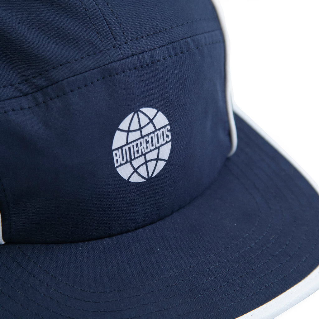 Butter Goods Piping Camp Cap in Navy / Forrest - Logo