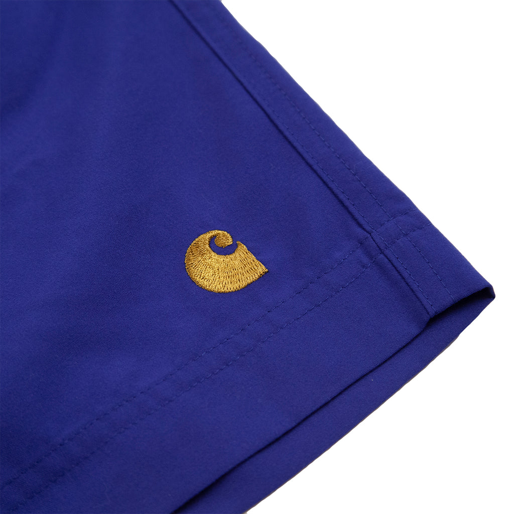 Carhartt WIP Chase Swim Shorts in Submarine / Gold - Embroidery