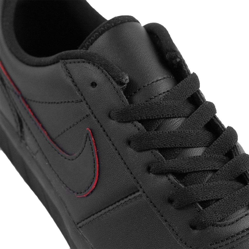 Nike SB Team Classic Premium Shoes in Black / Black / University Red - Pacific Blue - Laces