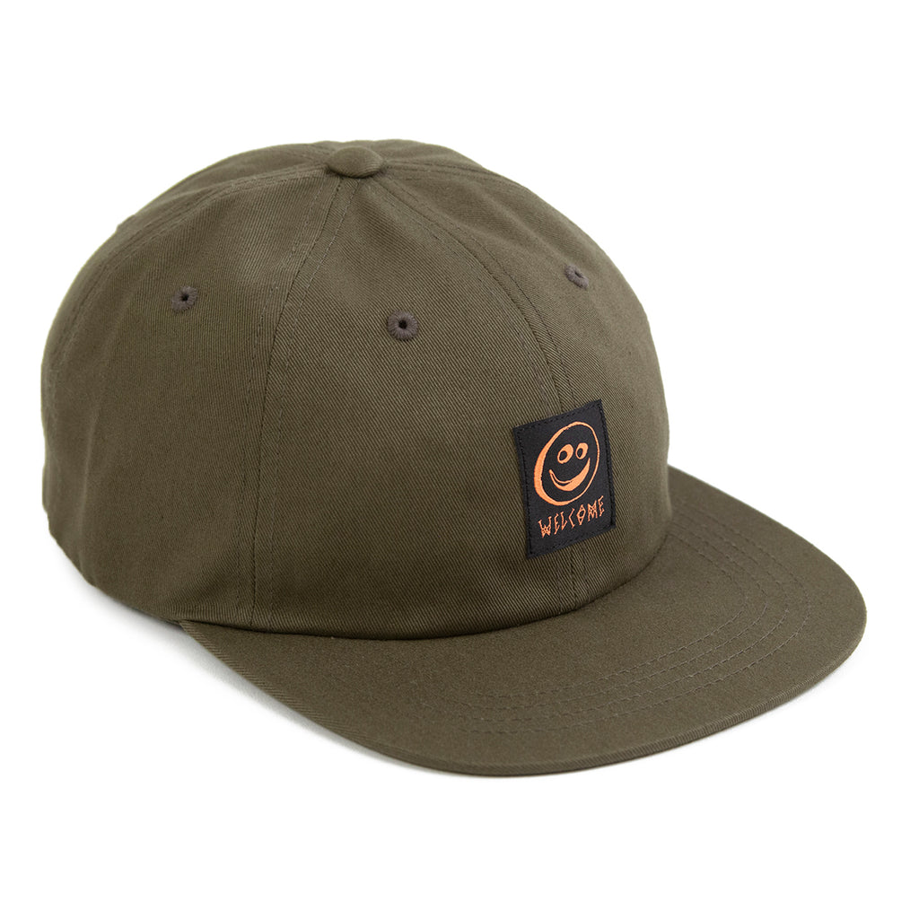 Welcome Skateboards Smiley Unstructured Snapback Cap in Olive