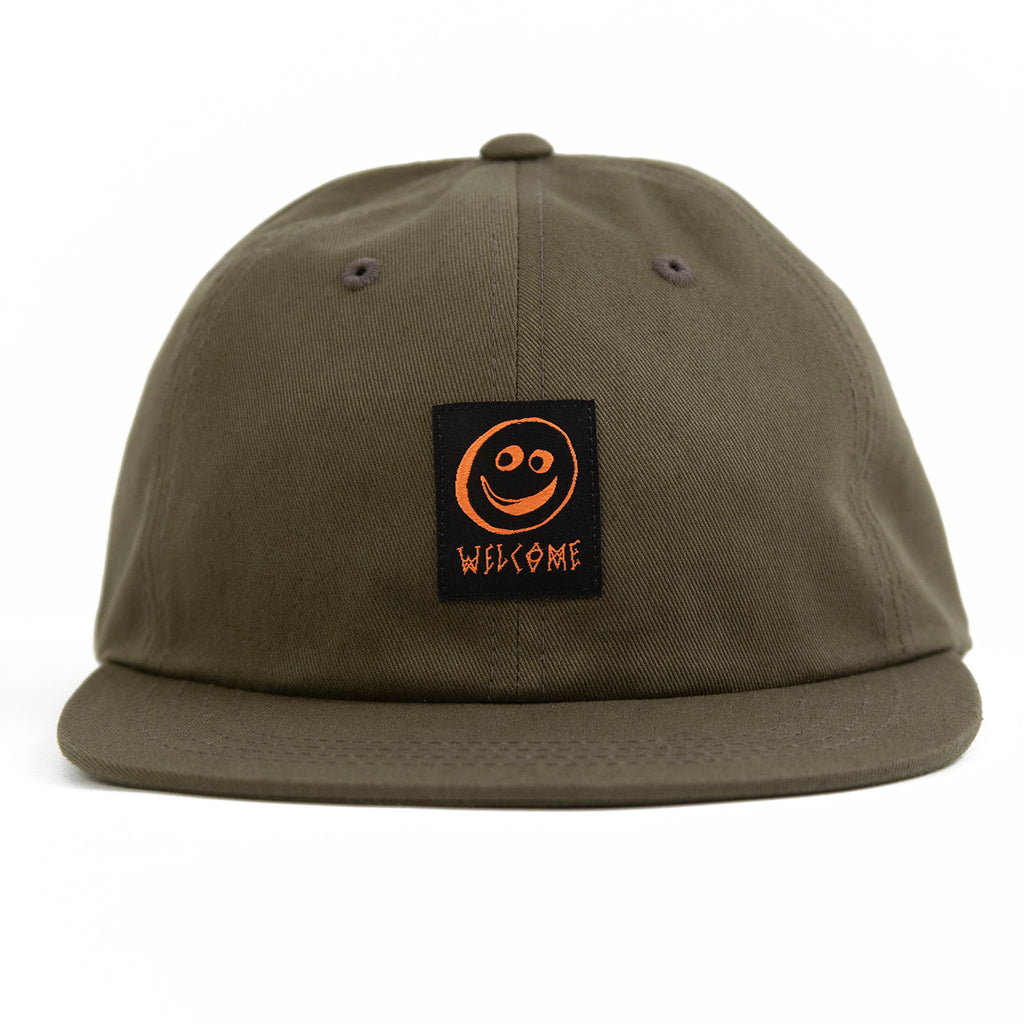 Welcome Skateboards Smiley Unstructured Snapback Cap in Olive - Front