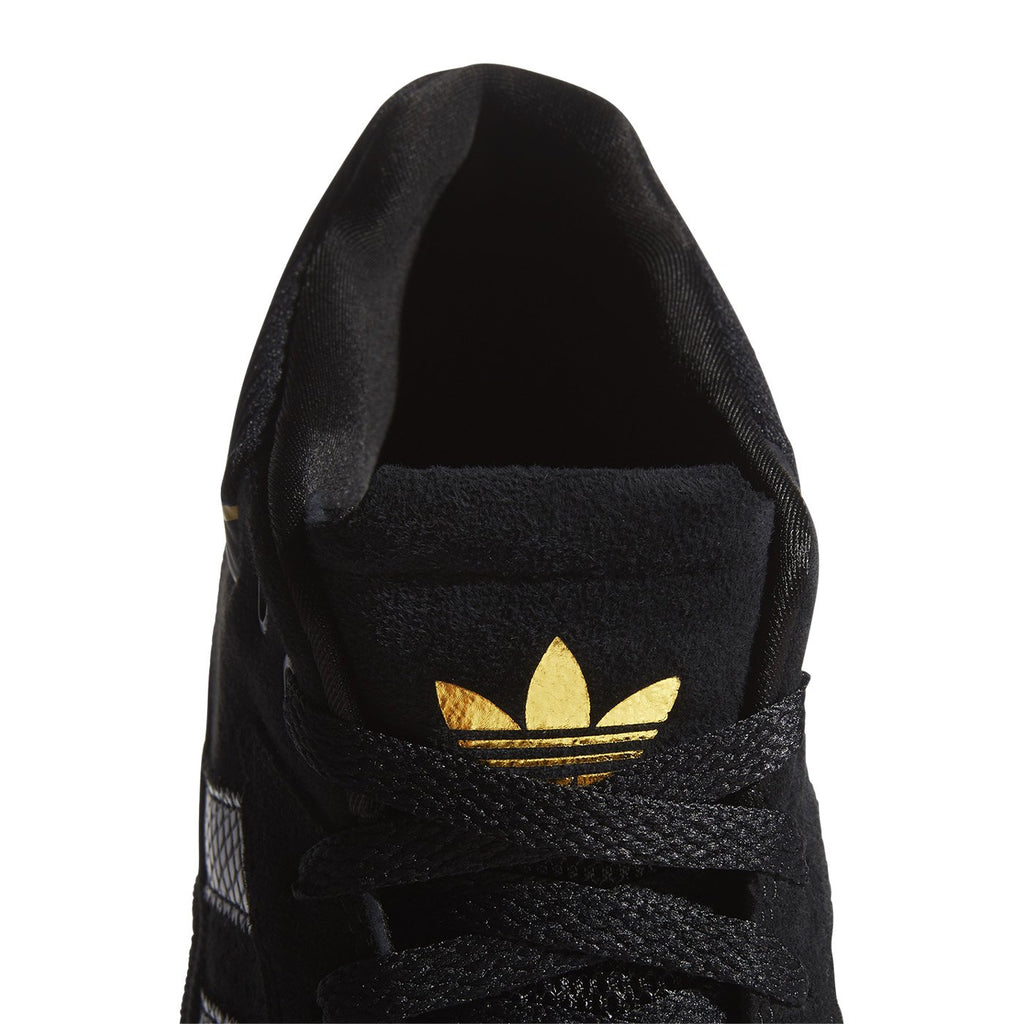Adidas Skateboarding Tyshawn Shoes in Core Black / Core Black / Gold Metallic - Tongue