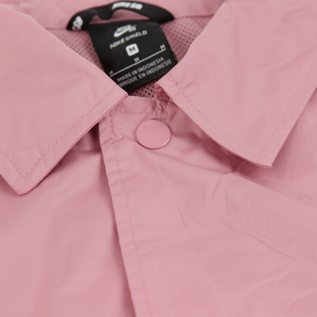 Nike SB Shield Coach Jacket in Elemental Pink / White - Collar
