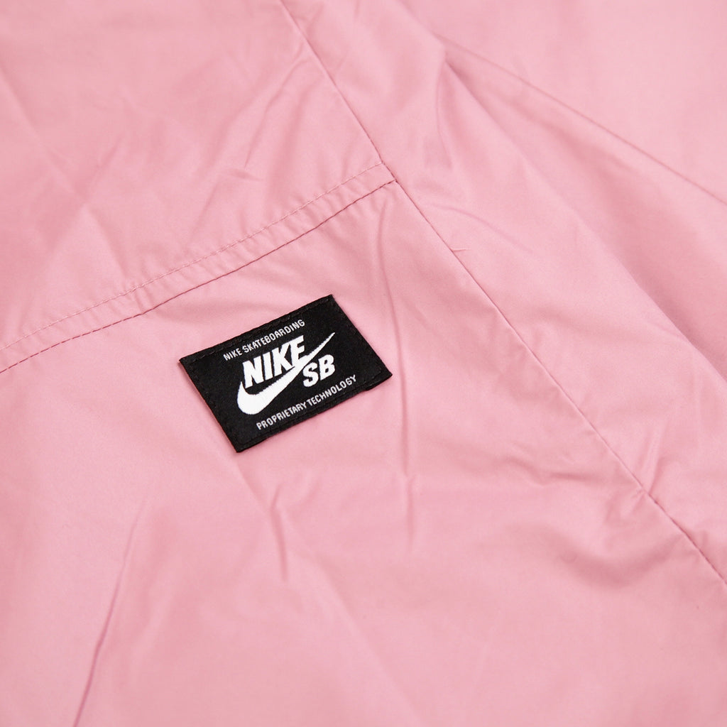 Nike SB Shield Coach Jacket in Elemental Pink / White - Labelling