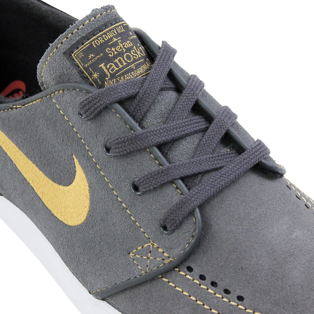 Nike SB Stefan Janoski Shoes in Anthracite / Metallic Gold / Black / Bright Crimson - Laces
