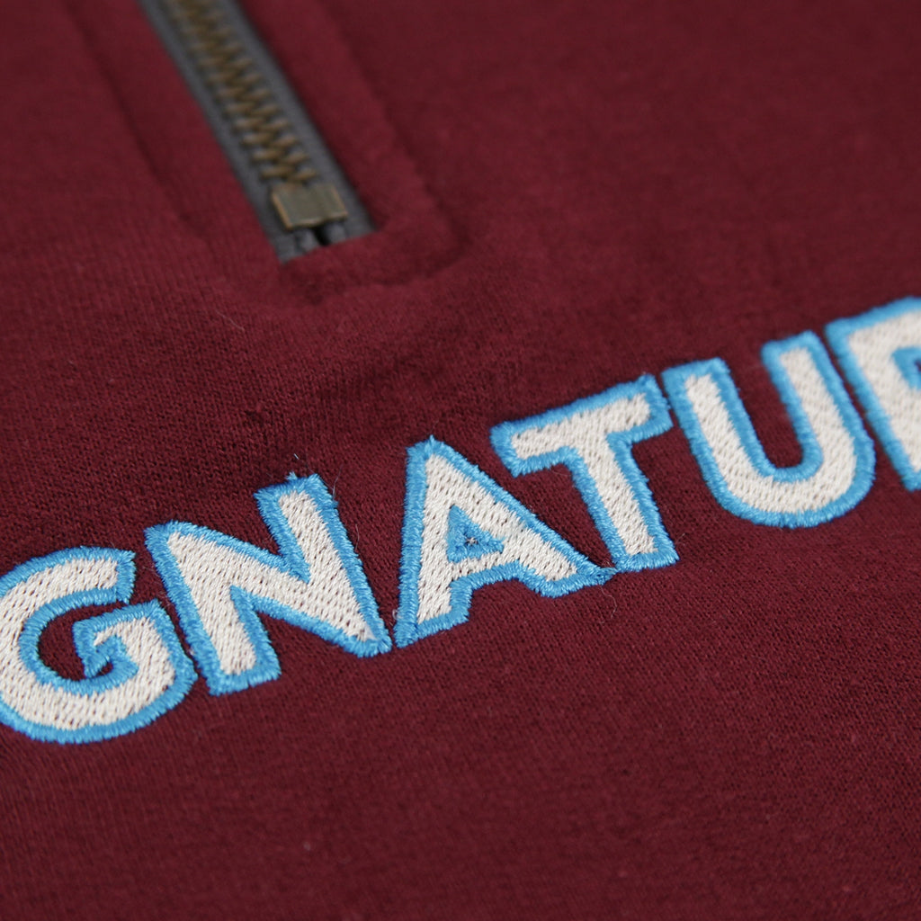 Signature Clothing Classic Logo Embroidered 1/4 Zip in Maroon - Close up