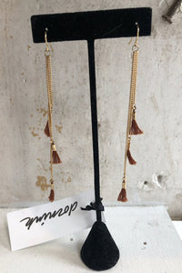 Gold dangle earrings with brown tassels