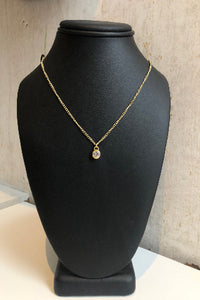 Gold rimmed crystal pendant necklace