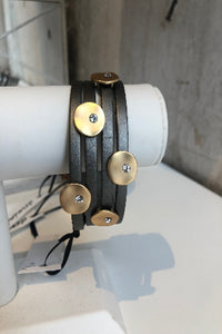 Leather bracelet with gold embellishments