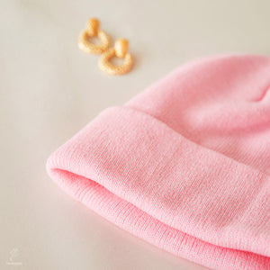the pink beanie