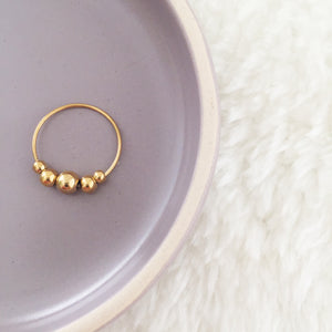 the golden dotted ring