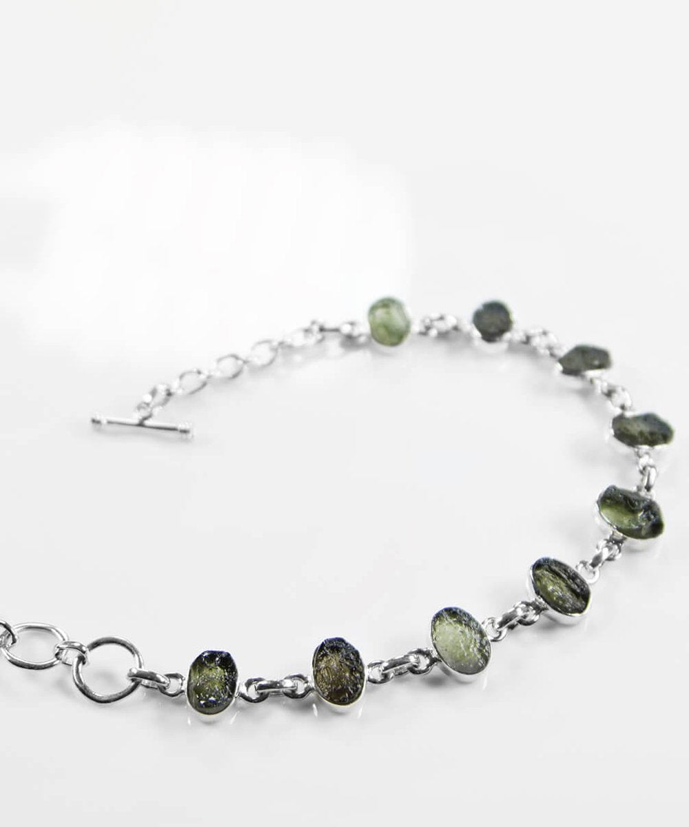 https://www.thefossilstore.com/collections/meteorites/products/moldavite-925-silver-bracelet-250mm