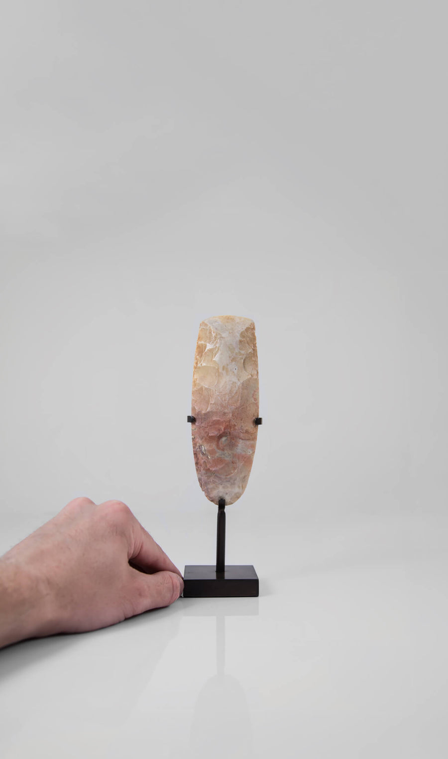 A unique and authentic Neolithic hand axe measuring 192mm is an intriguing craft created by an ancient hand