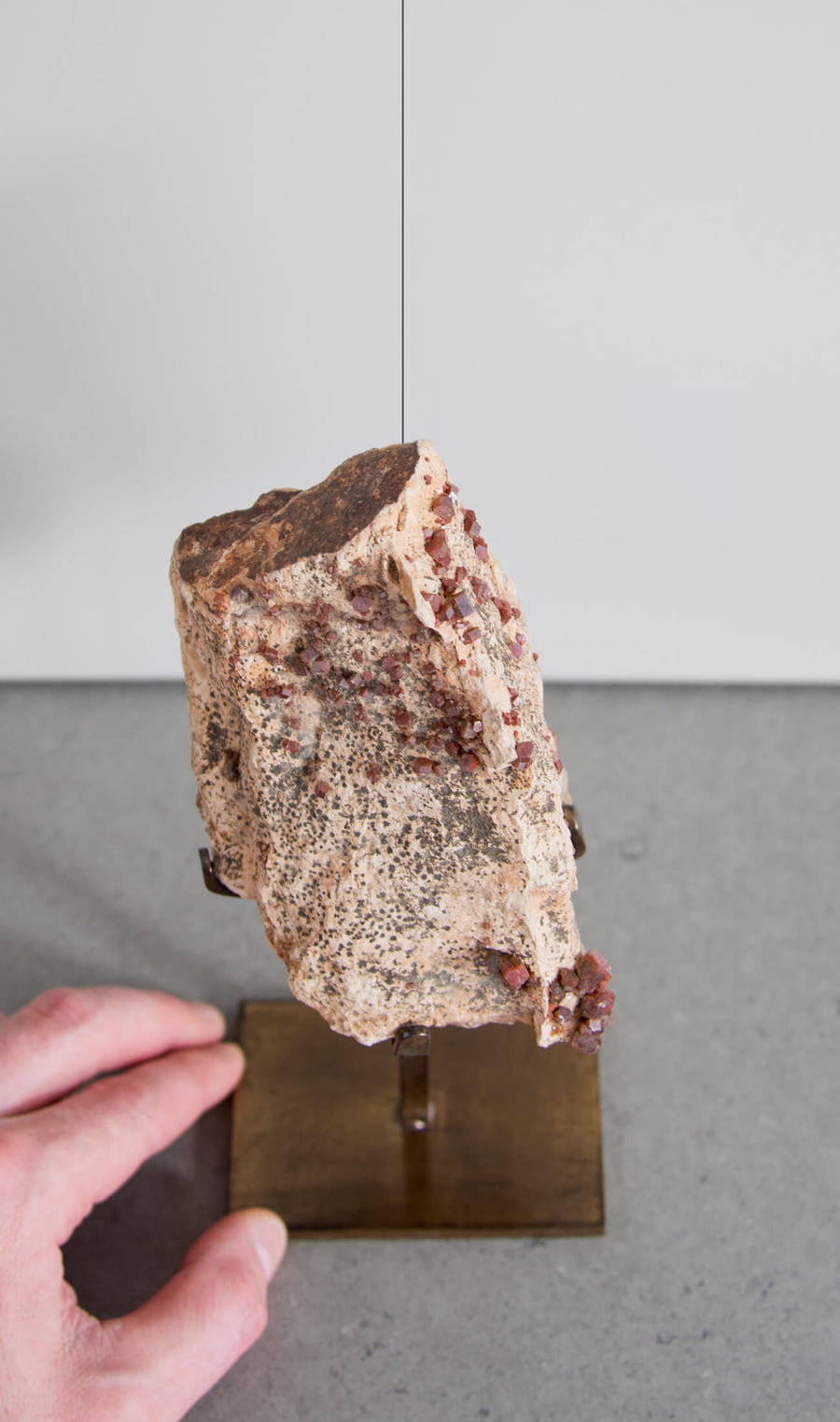 Beautiful red Vanadanite mineral gems in pink stone on a custom designed bronze Stand measuring 206mm