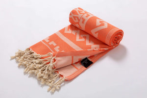 Serviette de plage design tapis aztèque couleur orange