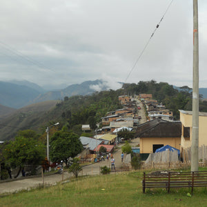 The town of Monserrate, Colombia.  A one road town with small houses on either side, at the top of a ridge.  The families in this town grow coffee as their main source of income.  The town also consists of a small public school, catholic church, and soccer field.