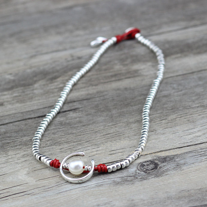 A gorgeous necklace, with handmade silver beads and a focal imitation pearl