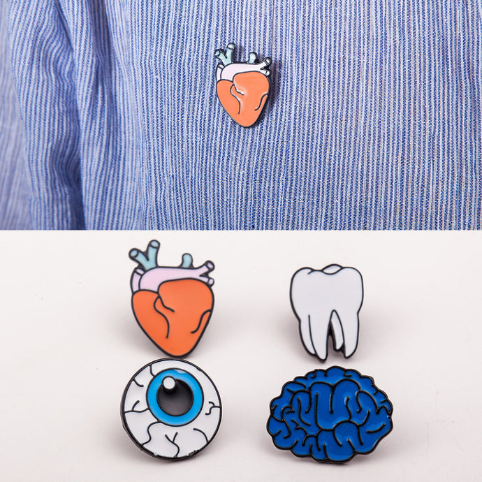 Brilliantly funny body part enamel brooch pins by Heed Need