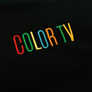 Retro COLOR TV Sign Embroidered Black Sweatshirt by Merch Motel