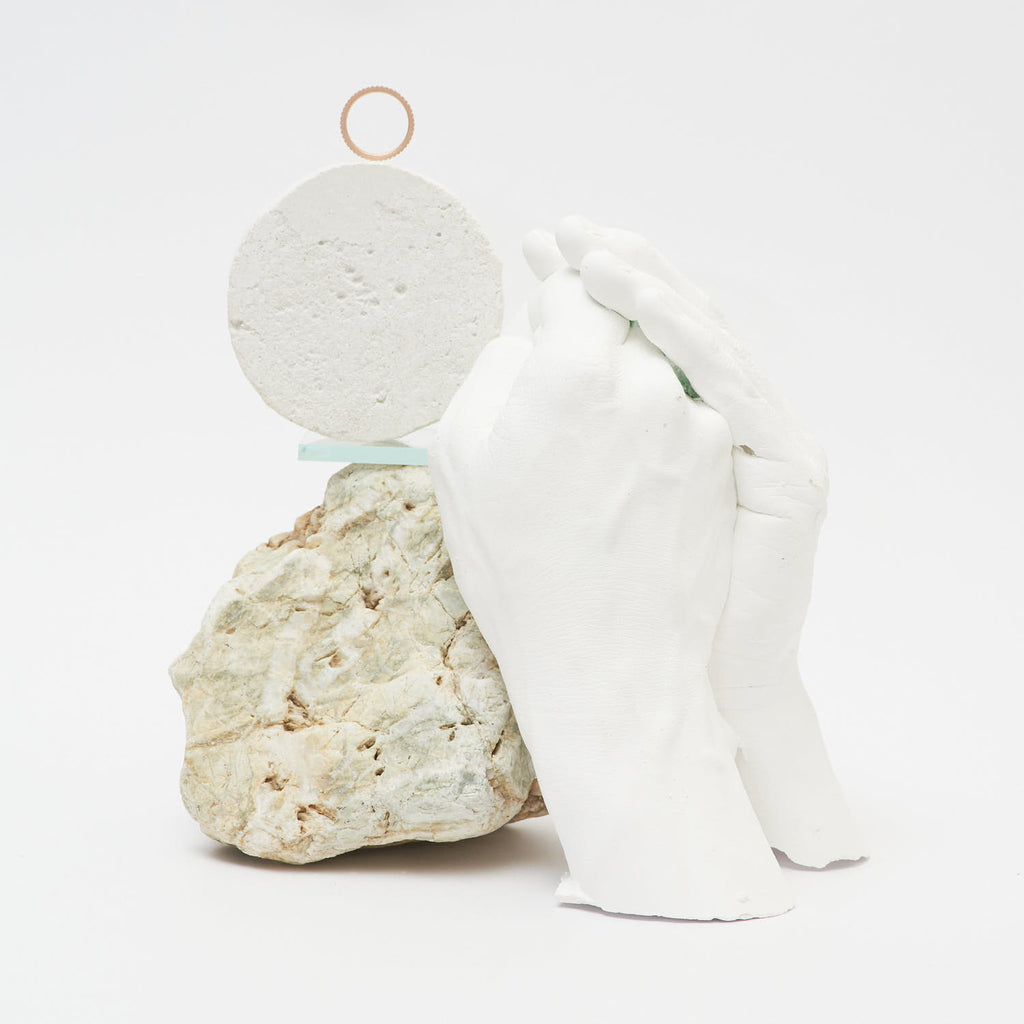 Still life photograph with Gleichenia ring, original sculpture and found objects