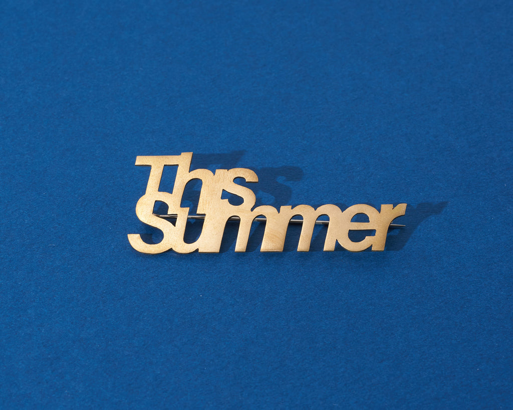 Gleichenia brooches inspred by word play and typo setting in brass base material finish.
