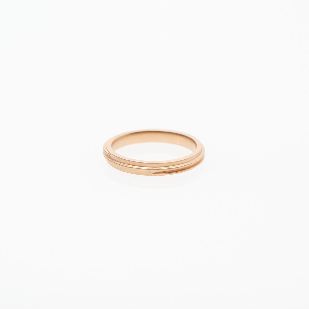 Gleichenia COIL ring in 18 karat pink gold has a spiral line spanning outer edge.