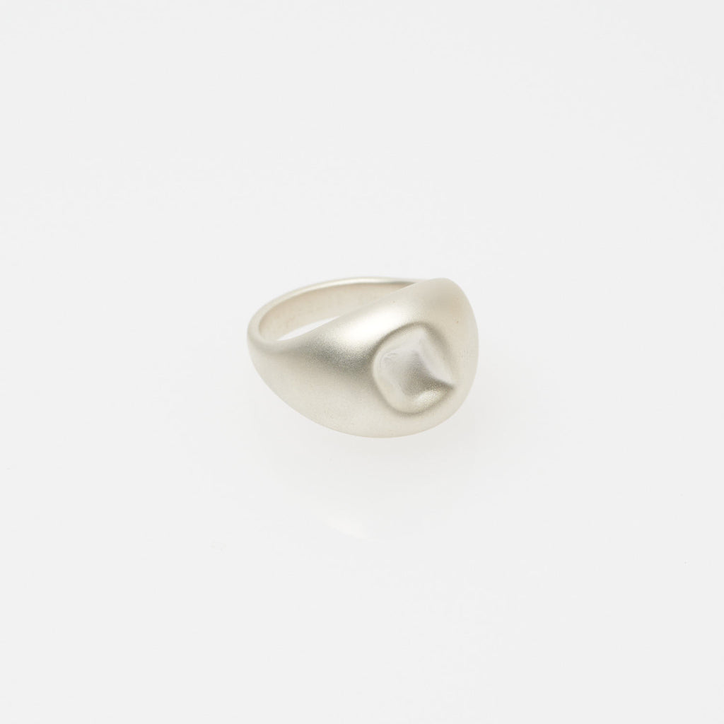 Gleichenia DENT ring. A hefty sterling silver ring that appears smashed on top with a matte finish.