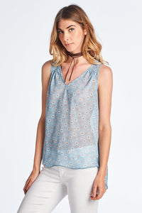 GEOMETRIC PRINT V-NECK TOP WITH HI-LO HEM AND BACK KEYHOLE