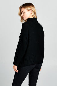TURTLENECK KNIT SWEATER WITH POM-POM DETAILS