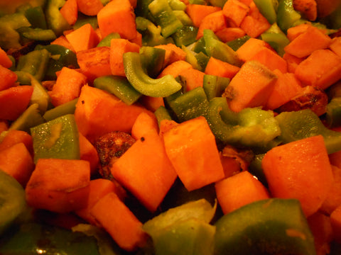 Sweet Potatoes and Peppers cooking in skillet